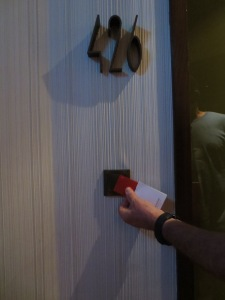 The gent demonstrated how to wave the keycard dealie over the magic spot so the door would open.